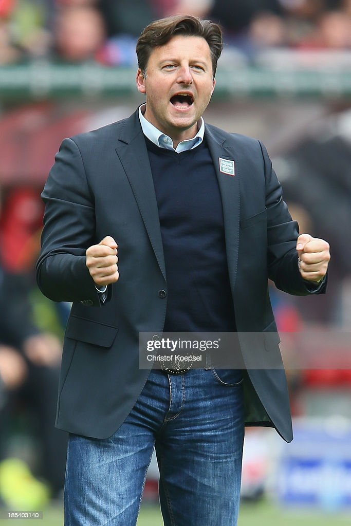 Head coach Kosta Runjaic of Kaiserslautern smiles during the the Second Bundesliga match between 1. FC Kaiserslautern and Karlsruher SC at Fritz-Walter-Stadion on October 20, 2013 in Kaiserslautern, Germany.