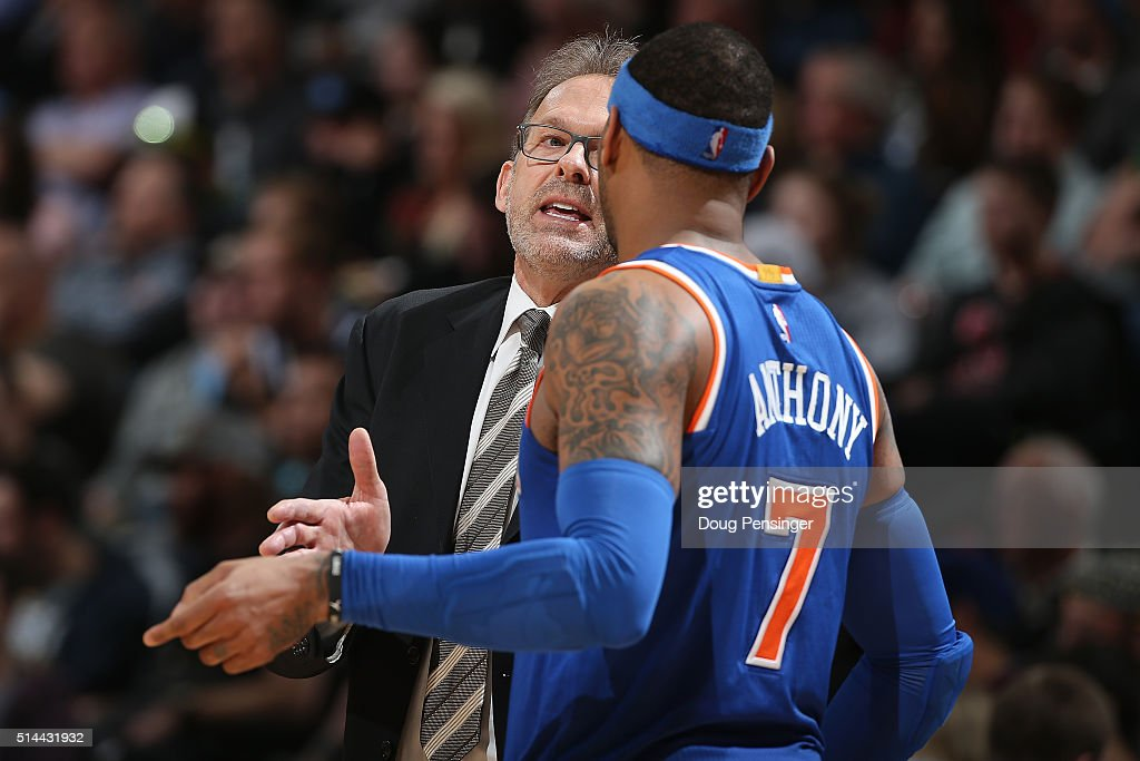 Head coach Kurt Rambis of the New York Knicks talks to Carmelo Anthony of the New York Knicks as they face the Denver Nuggets at Pepsi Center on...