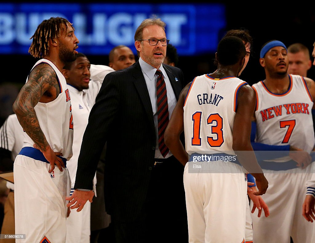 Head coach Kurt Rambis of the New York Knicks talks to his team during a time out in the first half against the Brooklyn Nets at Madison Square...