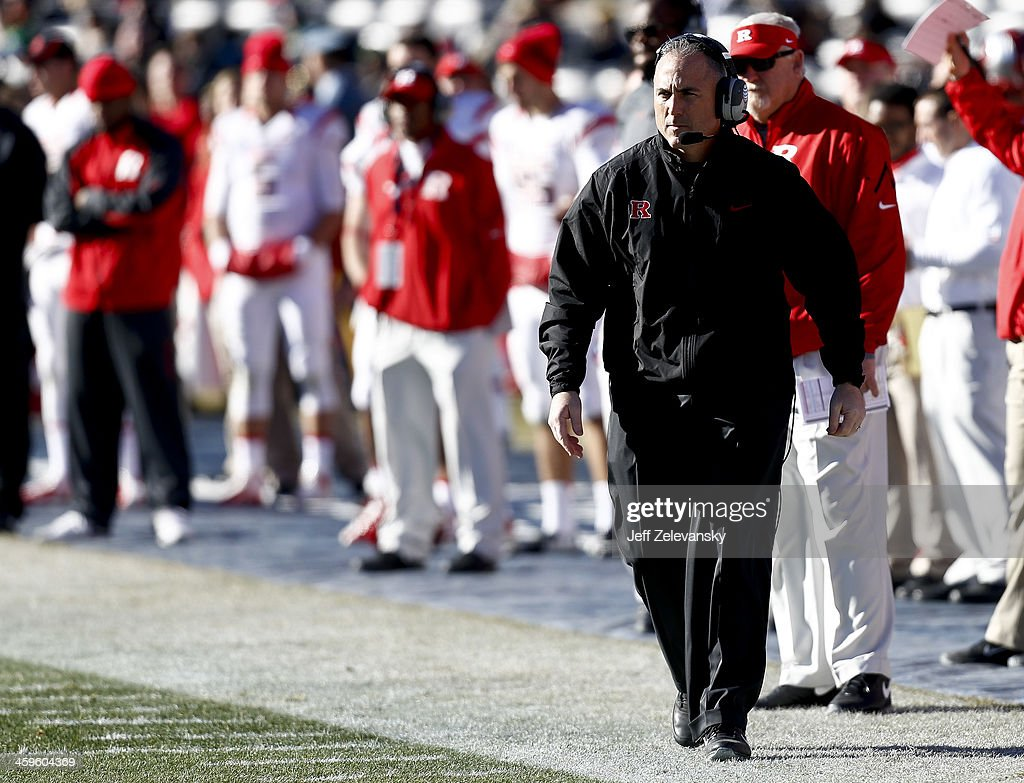 Head coach Kyle Flood of the Rutgers Scarlet Knights walks on the sidelines during the New Era Pinstripe Bowl against the Notre Dame Fighting Irish at Yankee Stadium on December 28, 2013 in the Bronx borough of New York City.