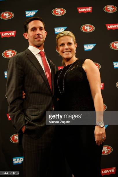 Head Coach Kyle Shanahan of the San Francisco 49ers stands with his wife during a press conference at Levi Stadium on February 9 2017 in Santa Clara...