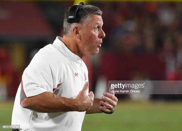 Head coach Kyle Whittingham of the Utah Utes questions the official about a delay of game penalty in the fourth quarter of the game against the USC...