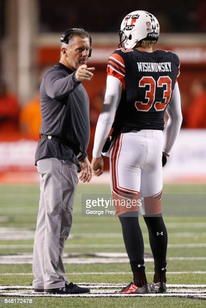 Head coach Kyle Whittingham of the Utah Utes talks to his player punter Mitch Wishnowsky of the Utah Utes during the first of an college football...