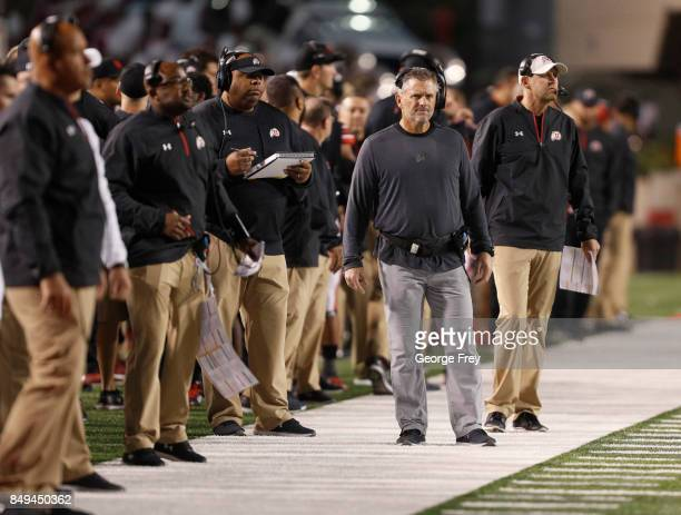 Head Coach Kyle Whittingham of the Utah Utes walks the sidelines with other Utah Coaches during the first of an college football game against the San...