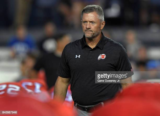 Head coach Kyle Whittingham of the Utah Utes watches practice prior to their game against the Brigham Young Cougars at LaVell Edwards Stadium on...