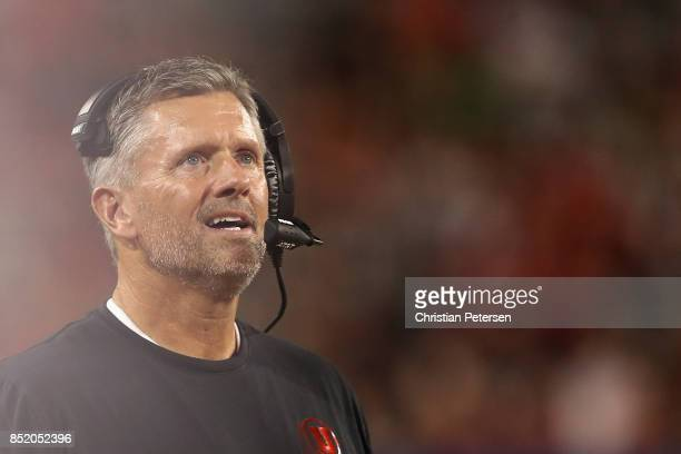 Head coach Kyle Whittingham of the Utah Utes watchs from the sidelines during the first half of the college football game against the Arizona...