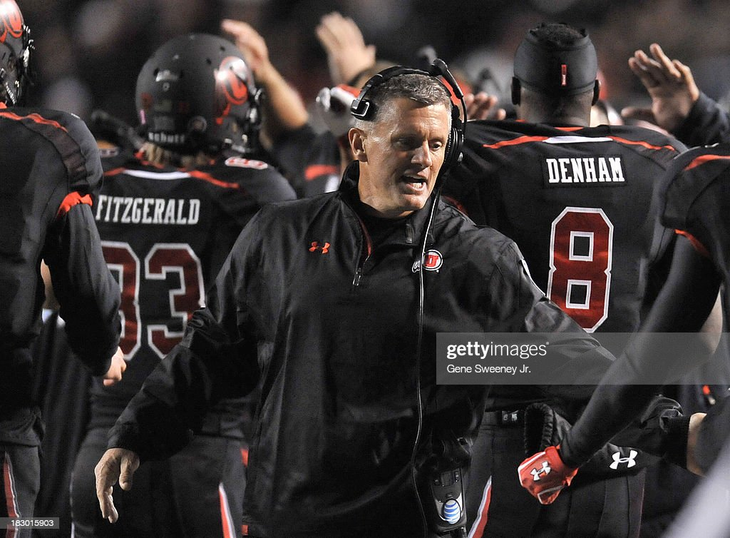 Head coach <a gi-track='captionPersonalityLinkClicked' href=/galleries/search?phrase=Kyle+Whittingham&family=editorial&specificpeople=2632741 ng-click='$event.stopPropagation()'>Kyle Whittingham</a> of Utah congratulates Dres Anderson #6 after his second quarter touchdown against UCLA at Rice- Eccles Stadium October 3, 2013 in Salt Lake City, Utah.