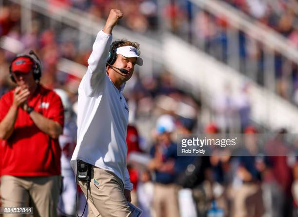 Head coach Lane Kiffin of the Florida Atlantic Owls pumps his fist during the Conference USA Championship game against the North Texas Mean Green at...