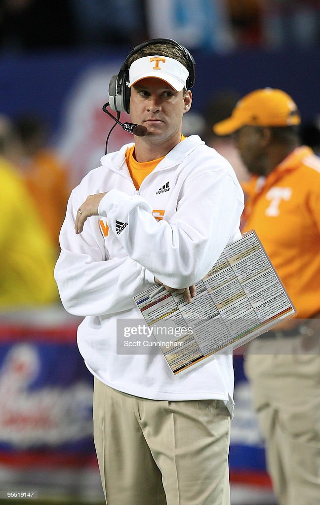 Head Coach <a gi-track='captionPersonalityLinkClicked' href=/galleries/search?phrase=Lane+Kiffin&family=editorial&specificpeople=4120527 ng-click='$event.stopPropagation()'>Lane Kiffin</a> of the Tennessee Volunteers watches the action during the Chick-Fil-A Bowl game against the Virginia Tech Hokies at the Georgia Dome on December 31, 2009 in Atlanta, Georgia. Virginia Tech defeated Tennessee 37-14.