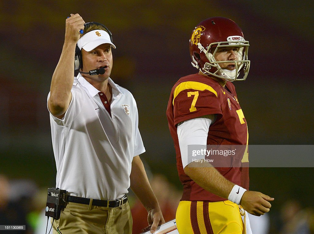 Head Coach <a gi-track='captionPersonalityLinkClicked' href=/galleries/search?phrase=Lane+Kiffin&family=editorial&specificpeople=4120527 ng-click='$event.stopPropagation()'>Lane Kiffin</a> of the USC Trojans and <a gi-track='captionPersonalityLinkClicked' href=/galleries/search?phrase=Matt+Barkley&family=editorial&specificpeople=5528198 ng-click='$event.stopPropagation()'>Matt Barkley</a> #7 react to a play from the sidelines during a 49-10 win over the Hawaii Warriors at Los Angeles Coliseum on September 1, 2012 in Los Angeles, California.