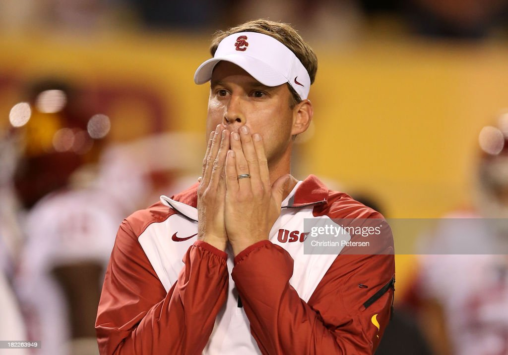 Head coach <a gi-track='captionPersonalityLinkClicked' href=/galleries/search?phrase=Lane+Kiffin&family=editorial&specificpeople=4120527 ng-click='$event.stopPropagation()'>Lane Kiffin</a> of the USC Trojans reacts during the college football game against the Arizona State Sun Devils at Sun Devil Stadium on September 28, 2013 in Tempe, Arizona.