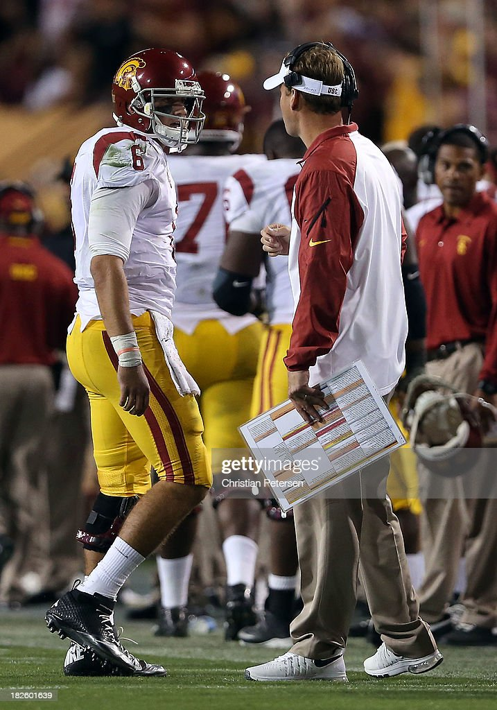 Head coach <a gi-track='captionPersonalityLinkClicked' href=/galleries/search?phrase=Lane+Kiffin&family=editorial&specificpeople=4120527 ng-click='$event.stopPropagation()'>Lane Kiffin</a> of the USC Trojans talks with quarterback Cody Kessler #6 during the college football game against the Arizona State Sun Devils at Sun Devil Stadium on September 28, 2013 in Tempe, Arizona. The Sun Devils defeated the Trojans 62-41.