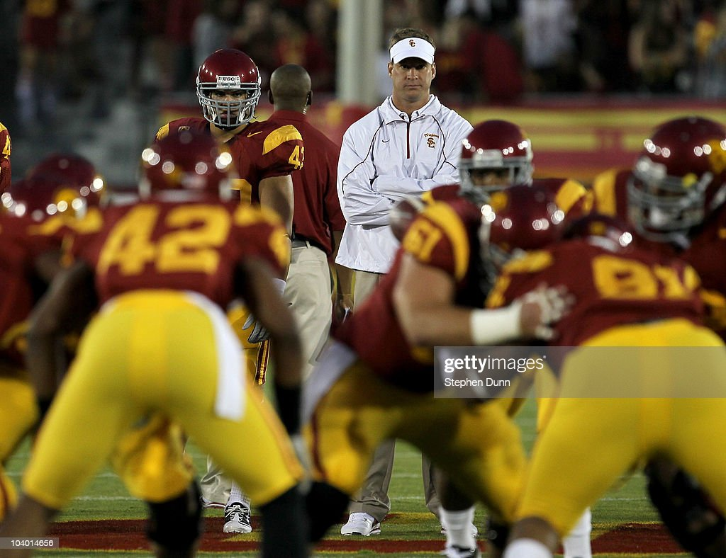 Head coach <a gi-track='captionPersonalityLinkClicked' href=/galleries/search?phrase=Lane+Kiffin&family=editorial&specificpeople=4120527 ng-click='$event.stopPropagation()'>Lane Kiffin</a> watches the USC Trojans warm up for their game with the Virginia Cavaliers at Los Angeles Memorial Coliseum on September 11, 2010 in Los Angeles, California.