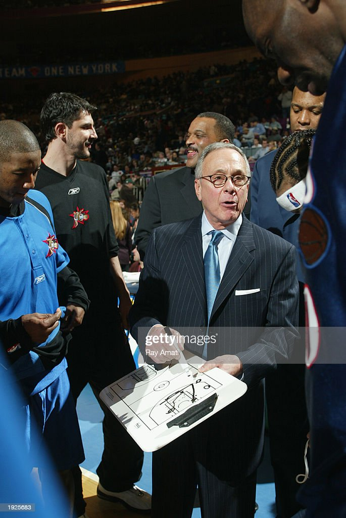 Head Coach Larry Brown of the Philadelphia 76ers goes through a play during a timeout against the New York Knicks at Madison Square Garden on April 11, 2003 in New York, New York.