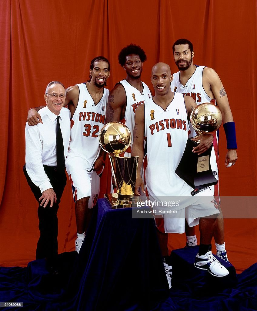 Head Coach Larry Brown, Richard Hamilton #32, Ben Wallace #3, Chauncey Billups #1 and Rasheed Wallace #30 of the Detroit Pistons pose with the championship trophy after Game Five of the 2004 NBA Finals on June 15, 2004 at The Palace of Auburn Hills in Auburn Hills, Michigan.
