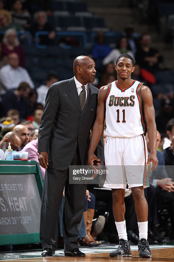Head coach Larry Drew and Brandon Knight #11 of the Milwaukee Bucks talk on the sideline against the Orlando Magic on March 10, 2014 at the BMO Harris Bradley Center in Milwaukee, Wisconsin.