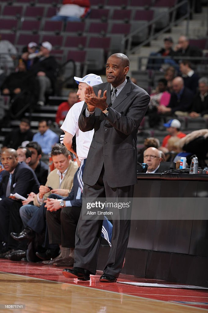 Head Coach Larry Drew of the Atlanta Hawks applauds during the game between the Detroit Pistons and the Atlanta Hawks on February 25, 2013 at The Palace of Auburn Hills in Auburn Hills, Michigan.