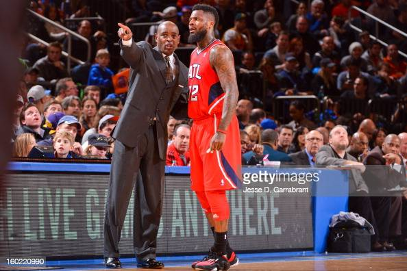 Head Coach Larry Drew of the Atlanta Hawks speaks to DeShawn Stevenson during a game against the New York Knicks at Madison Square Garden on January...