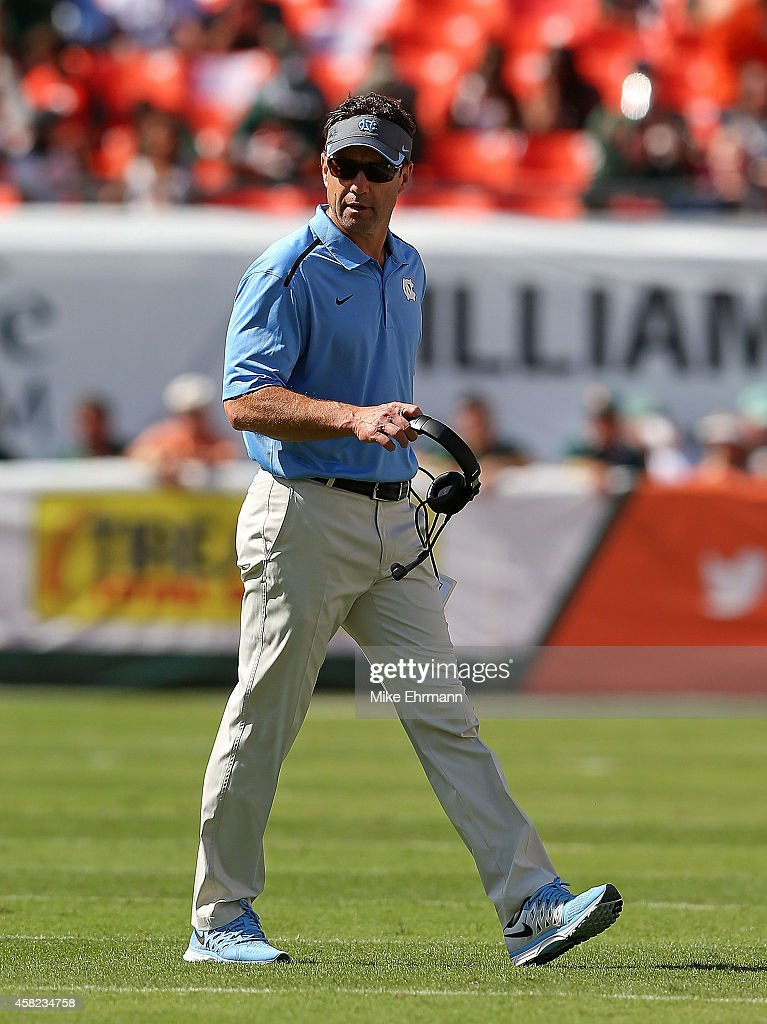 Head coach Larry Fedora of the North Carolina Tar Heels looks on during a game at Sun Life Stadium on November 1, 2014 in Miami Gardens, Florida.