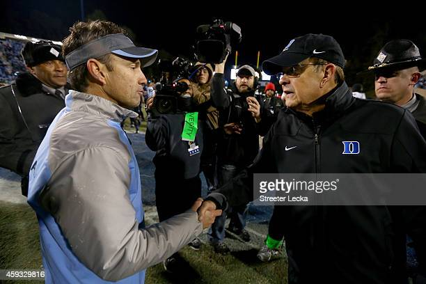 Head coach Larry Fedora of the North Carolina Tar Heels shakes hands with head coach David Cutcliffe of the Duke Blue Devils after defeating the Blue...