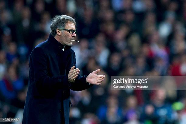 Head coach Laurent Blanc of Paris SaintGermain encourages his team during the UEFA Champions League Group A match between Real Madrid CF and Paris...