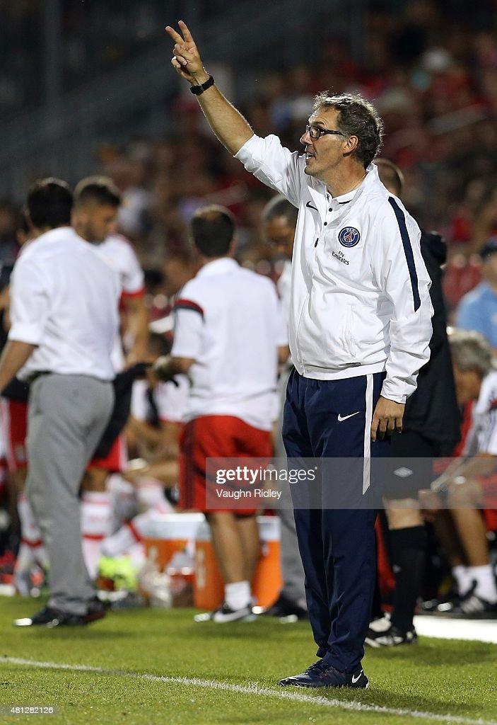 Head Coach Laurent Blanc of Paris Saint-Germain gives instructions from the sideline during the 2015 International Champions Cup match against Benfica at BMO Field on July 18, 2015 in Toronto, Ontario, Canada.