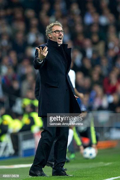 Head coach Laurent Blanc of Paris SaintGermain gives instructions during the UEFA Champions League Group A match between Real Madrid CF and Paris...