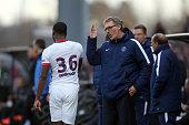 Head coach Laurent Blanc speaks with Yakou MEITE of Paris SaintGermain during the French League 1 match between EA Guingamp and Paris SaintGermain on...