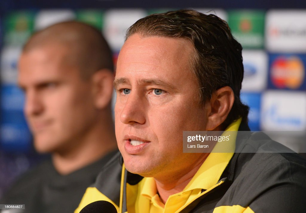 Head coach Laurentju Reghecampf is seen next to <a gi-track='captionPersonalityLinkClicked' href=/galleries/search?phrase=Alexandru+Bourceanu&family=editorial&specificpeople=6597771 ng-click='$event.stopPropagation()'>Alexandru Bourceanu</a> during a FC Steaua Bucuresti press conference ahead of their UEFA Champions League Group E match against FC Schalke 04 at Veltins-Arena on September 17, 2013 in Gelsenkirchen, Germany.