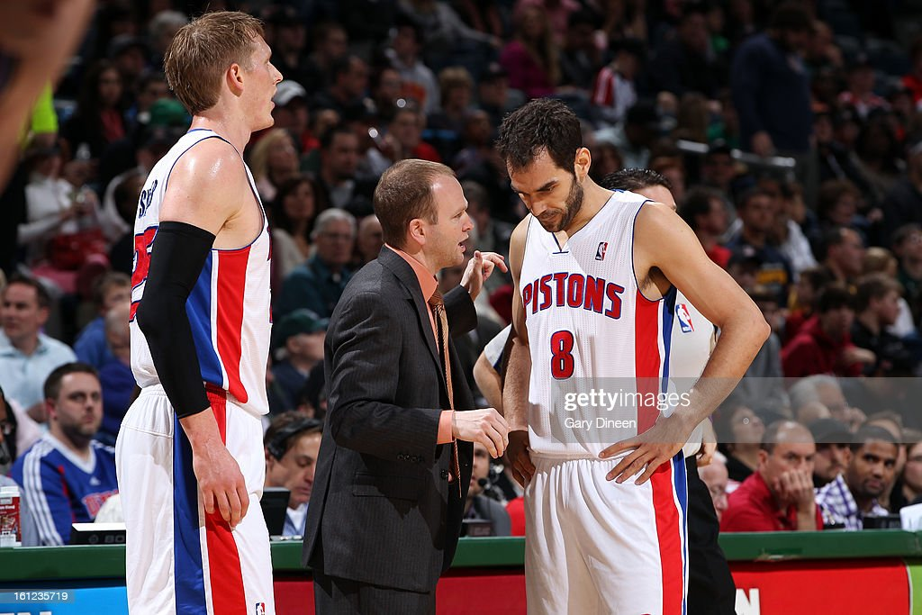 Head Coach Lawrence Frank and Jose Calderon #8 of the Detroit Pistons speak on the court during the game against the Milwaukee Bucks on February 9, 2013 at the BMO Harris Bradley Center in Milwaukee, Wisconsin.
