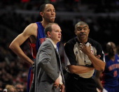 Head coach Lawrence Frank of the Detroit Pistons and Tayshaun Prince listen to referee Tony Brothers during a loss to the Chicago Bulls at the United...