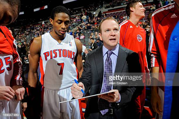 Head Coach Lawrence Frank of the Detroit Pistons draws up plays for Brandon Knight and other players before playing against the Charlotte Bobcats on...