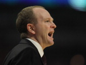 Head coach Lawrence Frank of the Detroit Pistons gives instructions to his team during a game against the Chicago Bulls at the United Center on...