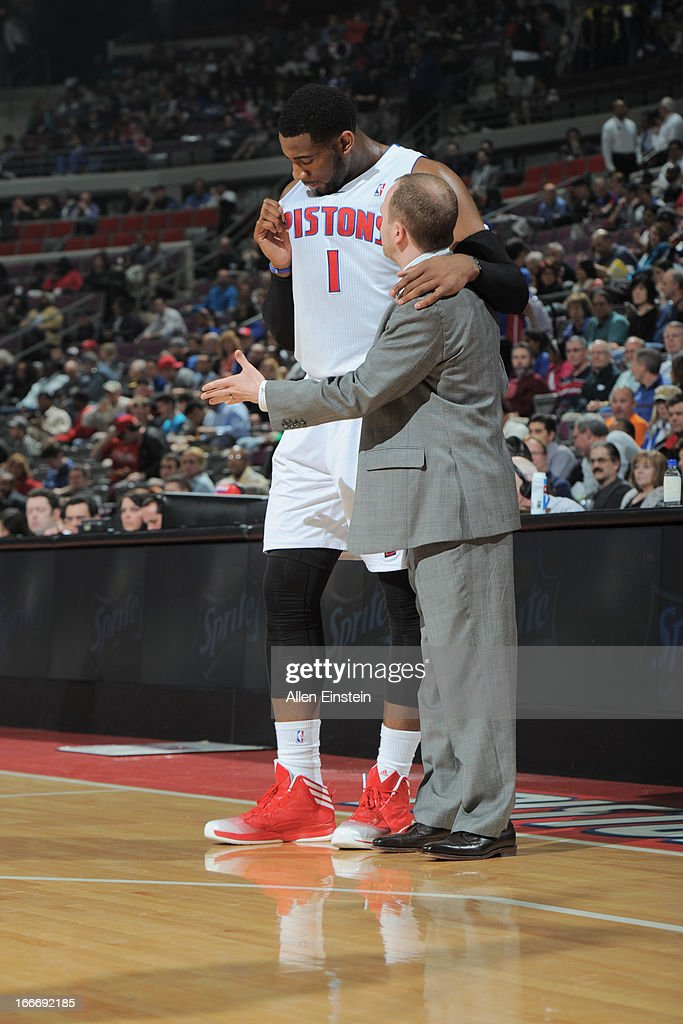 Head Coach <a gi-track='captionPersonalityLinkClicked' href=/galleries/search?phrase=Lawrence+Frank&family=editorial&specificpeople=208918 ng-click='$event.stopPropagation()'>Lawrence Frank</a> of the Detroit Pistons speaks with <a gi-track='captionPersonalityLinkClicked' href=/galleries/search?phrase=Andre+Drummond&family=editorial&specificpeople=7122456 ng-click='$event.stopPropagation()'>Andre Drummond</a> #1 of the Detroit Pistons during the game between the Detroit Pistons and the Philadelphia 76ers on April 15, 2013 at The Palace of Auburn Hills in Auburn Hills, Michigan.