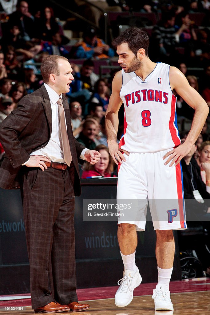 Head Coach Lawrence Frank of the Detroit Pistons speaks with Jose Calderon #8 during a game against the San Antonio Spurs on February 8, 2013 at The Palace of Auburn Hills in Auburn Hills, Michigan.