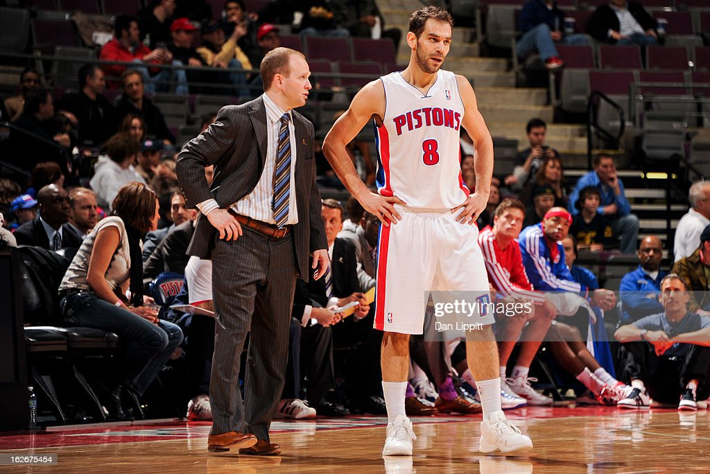 Head Coach Lawrence Frank of the Detroit Pistons speaks with Jose Calderon #8 during a game against the Atlanta Hawks on February 25, 2013 at The Palace of Auburn Hills in Auburn Hills, Michigan.