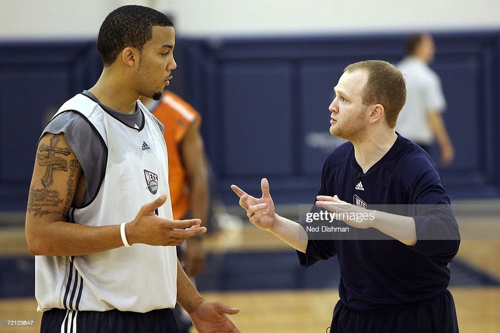 Head coach Lawrence Frank speaks with Marcus Williams of the New Jersey Nets during training camp on October 9 2006 at the New Jersey Nets practice...