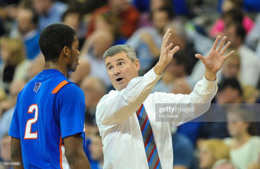 Head coach Leon Rice of the Boise State Broncos talks to Derrick Marks #2 of the Boise State Broncos during a time out of their game against the Creighton Bluejays at CenturyLink Center on November 28, 2012 in Omaha, Nebraska. Boise State beat Creighton 83-70.