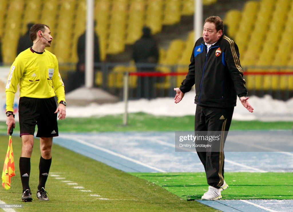 Head coach Leonid Slutsky (R) of PFC CSKA Moscow appeals to the referee Assistant queries during the Russian Premier League match between PFC CSKA Moscow and FC Mordovia Saransk at the Luzhniki Stadium on December 09, 2012 in Moscow, Russia.