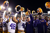 Head coach Les Miles celebrates with the LSU Tigers after defeating the Florida Gators 3528 at Tiger Stadium on October 17 2015 in Baton Rouge...