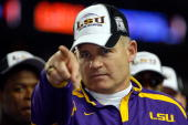 Head coach Les Miles of the Louisiana State University Tigers celebrates after defeating the University of Tennessee Volunteers 2114 in the SEC...