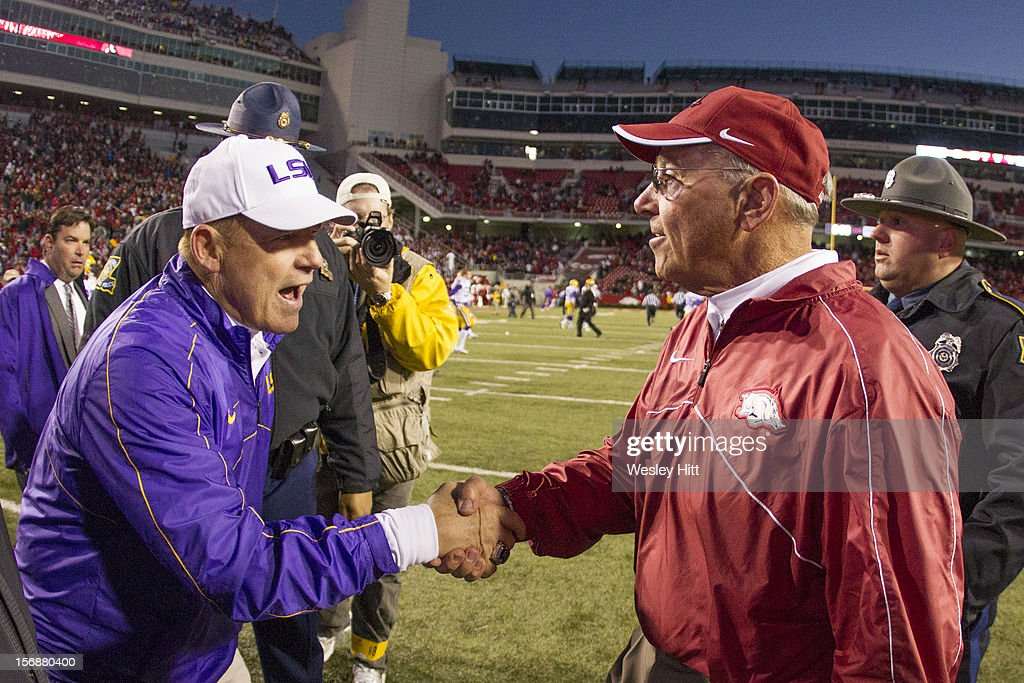 Head Coach <a gi-track='captionPersonalityLinkClicked' href=/galleries/search?phrase=Les+Miles&family=editorial&specificpeople=2109775 ng-click='$event.stopPropagation()'>Les Miles</a> of the LSU Tigers and John L. Smith of the Arkansas Razorbacks shake hands after the game at Razorback Stadium on November 23, 2012 in Fayetteville, Arkansas. The Tigers defeated the Razorbacks 20-13.