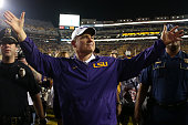 Head coach Les Miles of the LSU Tigers celebrates after defeating the Texas AM Aggies 197 at Tiger Stadium on November 28 2015 in Baton Rouge...