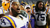 Head coach Les Miles of the LSU Tigers celebrates with his team after they defeated the Texas AM Aggies 2317 at Kyle Field on November 27 2014 in...