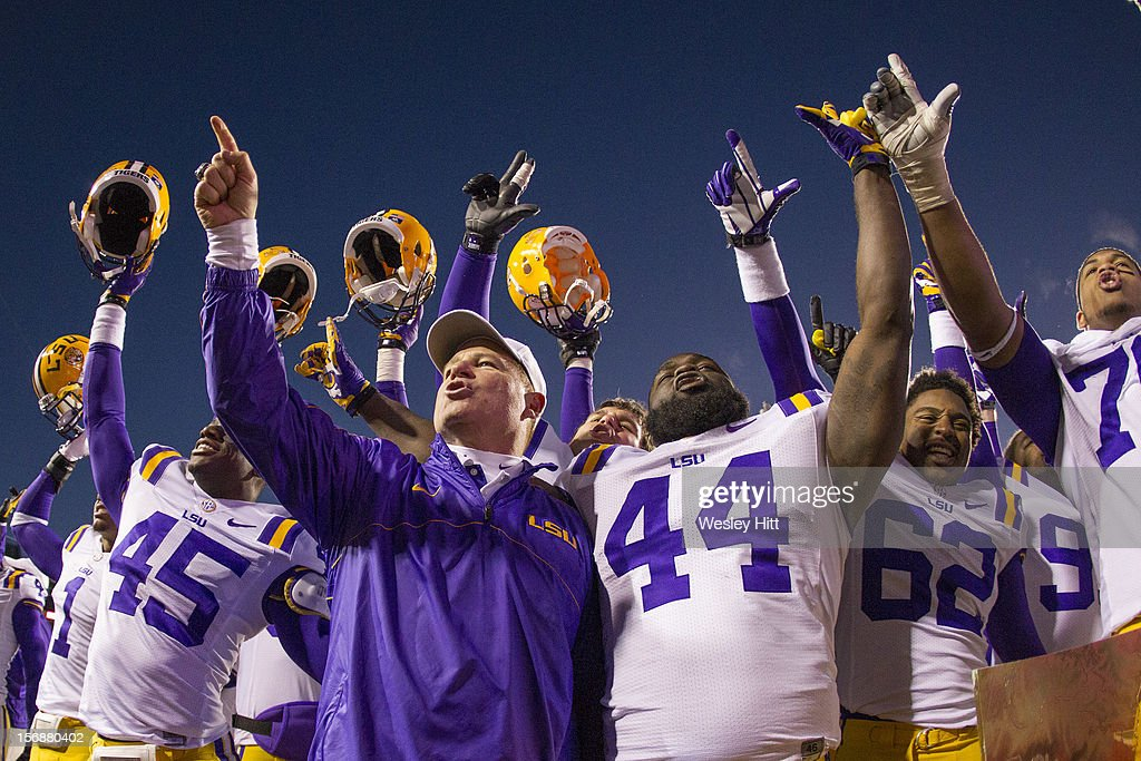 Head Coach Les Miles of the LSU Tigers leads his team in the fight song after a game against the Arkansas Razorbacks at Razorback Stadium on November 23, 2012 in Fayetteville, Arkansas. The Tigers defeated the Razorbacks 20-13.