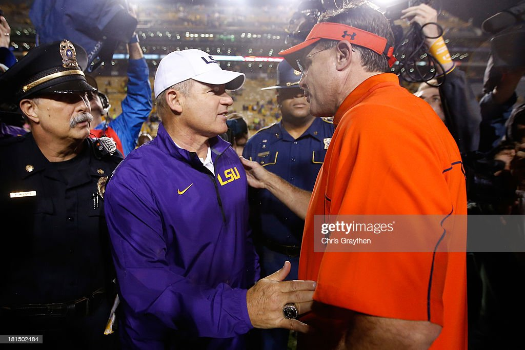 Head coach Les Miles of the LSU Tigers talks with ead coach Gus Malzahn of the Auburn Tigers after LSU defeated Auburn 35-21at Tiger Stadium on September 21, 2013 in Baton Rouge, Louisiana.
