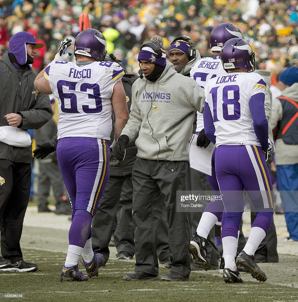 Head coach <a gi-track='captionPersonalityLinkClicked' href=/galleries/search?phrase=Leslie+Frazier&family=editorial&specificpeople=2295716 ng-click='$event.stopPropagation()'>Leslie Frazier</a> of the Minnesota Vikings greats players on a change of possesion during an NFL game against the Green Bay Packers at Lambeau Field, November 24, 2013 in Green Bay, Wisconsin.