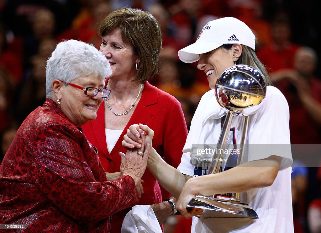 Head coach Lin Dunn of the Indiana Fever congratulates assistant coach <a gi-track='captionPersonalityLinkClicked' href=/galleries/search?phrase=Stephanie+White+-+Basketball+Player&family=editorial&specificpeople=225118 ng-click='$event.stopPropagation()'>Stephanie White</a> of the Indiana Fever after defeating the Minnesota Lynx in Game Four of the 2012 WNBA Finals on October 21, 2012 at Bankers Life Fieldhouse in Indianapolis, Indiana.
