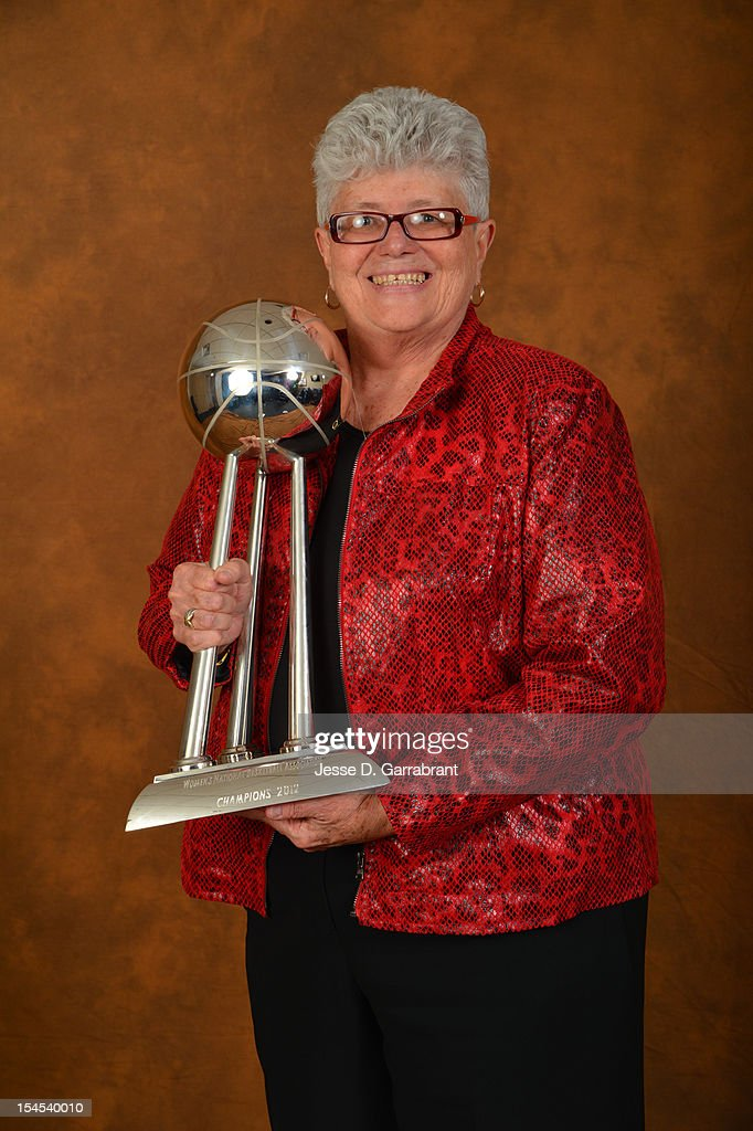 Head Coach Lin Dunn of the Indiana Fever poses for portraits with the Championship Trophy after Game four of the 2012 WNBA Finals on October 21, 2012 at Bankers Life Fieldhouse in Indianapolis, Indiana.