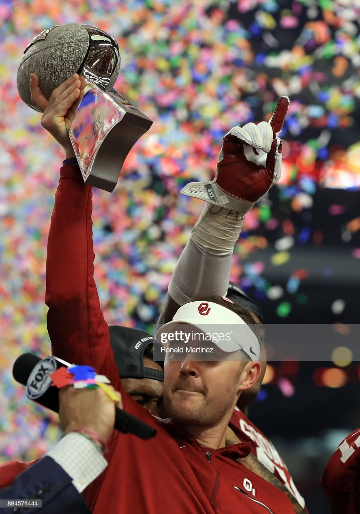 Head coach Lincoln Riley of the Oklahoma Sooners raises the Big 12 Championship trophy after defeating the TCU Horned Frogs 41-17 at AT&T Stadium on December 2, 2017 in Arlington, Texas.